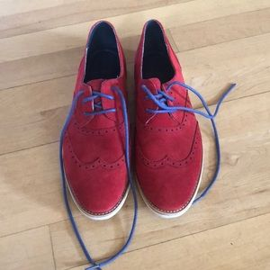 a pair of nice red shoes barely worn